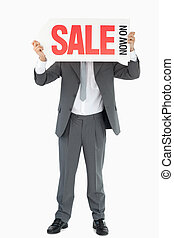 Businessman with sign in front of his head