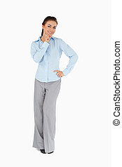 Smiling businesswoman in thoughts against a white background