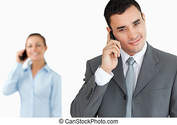 Business partners on the phone against a white background