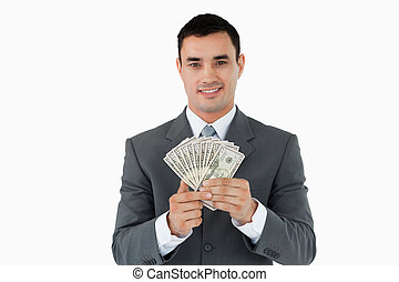 Businessman with bank notes against a white background