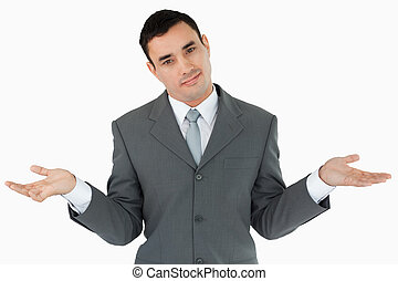 Businessman clueless against a white background