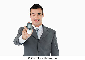 Smiling businessman showing his phone