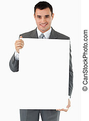 Businessman presenting sign