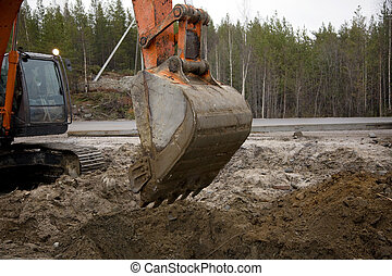 Excavator with a raised bucket - Crawler excavator working...