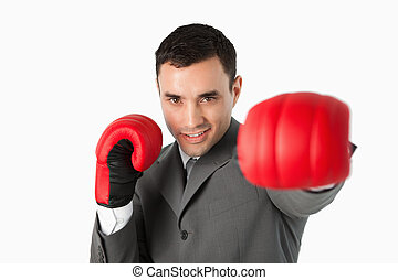 Businessman with boxing gloves on beating
