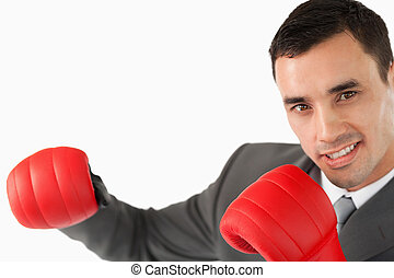 Side view of businessman with boxing gloves