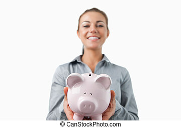 Piggy bank being held by bank assistant