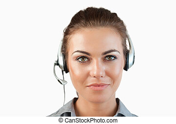 Close up of female call center agent against a white...