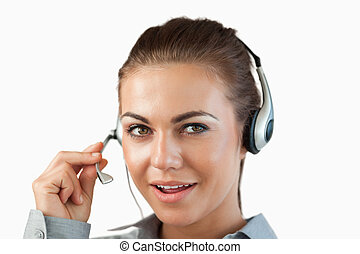 Close up of talking female call center agent