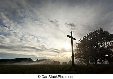 dramatic sky and a cross - An image of a dramatic sky and a...
