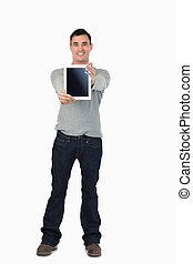 Young male presenting his tablet against a white background