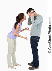 Young couple in a fight against a white background