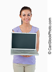 Smiling young female showing her laptop