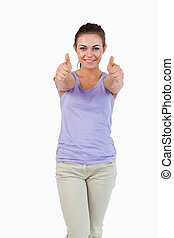 Young female giving thumbs up
