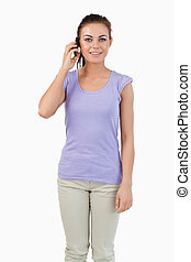 Young female listening to caller against a white background