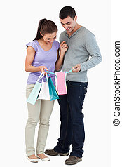Young couple looking at their shopping