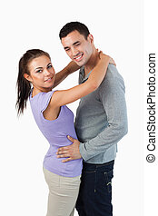 Side view of young couple hugging