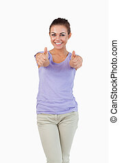 Smiling young female giving thumbs up