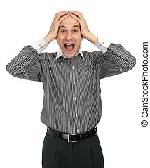 surprised businessman screaming while keeping his hands on head
