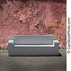 Stone sofa cracked plaster wall