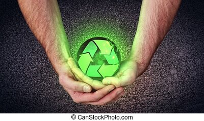 Hands holding a recycling symbol activating copy spaces