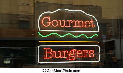 Gourmet burgers sign - Neon burger sign in restaurant window...