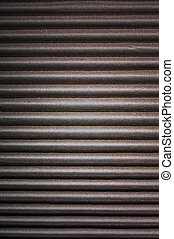 corrugated cardboard - texture of dark-faced corrugated...