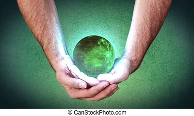 Hands holding a green globe and videos about green energies
