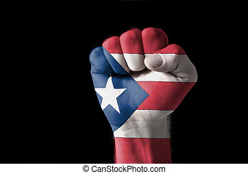 Fist painted in colors of puertorico flag - Low key picture...