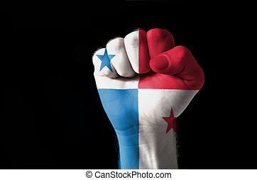 Fist painted in colors of panama flag - Low key picture of a...