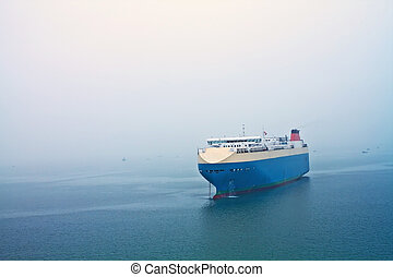 Cruise stops in the sea in a foggy day