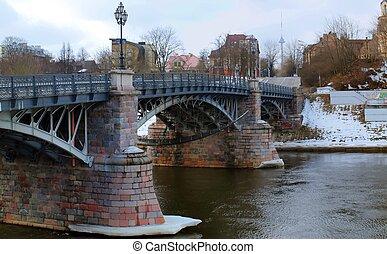 Old bridge and river in Vilnius city.