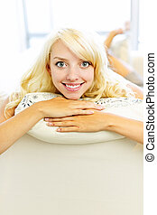 Smiling woman relaxing at home