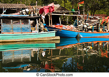 huts and colorful  fisher boats at the mangrove everglades in a s