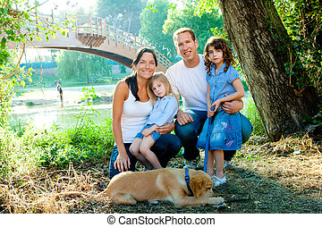 Family father mother kids and dog outdoor - Happy family...