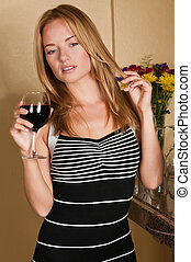 Blonde - Lovely young blonde holding a wine glass