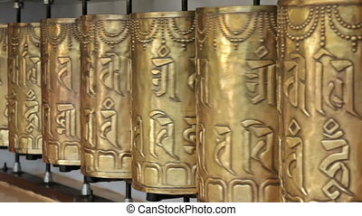 Spinning buddhist prayer wheels in Tsuglagkhang complex in...