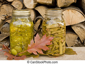canned beans and pickles - canned pickles and beans with a...