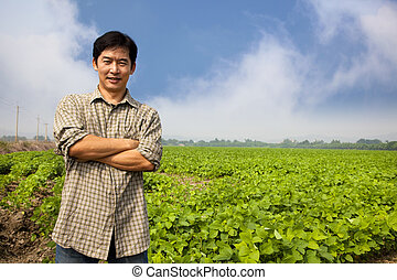 chinese middle aged  farmer and his farm
