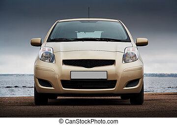 Front view of a beige car - Front view of a beige compact...