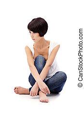 Brunette lady with blue eyes sitting on white background