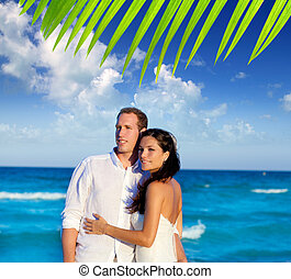 couple in love hug in blue sea vacation