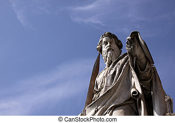 Saint Paul Statue - A statue of St Paul backed by blue sky,...