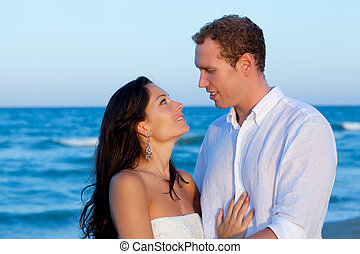 couple in love hug in blue sea vacation in Spain