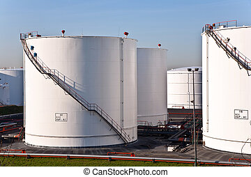 white tanks in tank farm with blue sky - white tanks in tank...