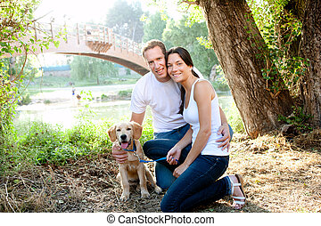 beautiful couple in forest with puppy