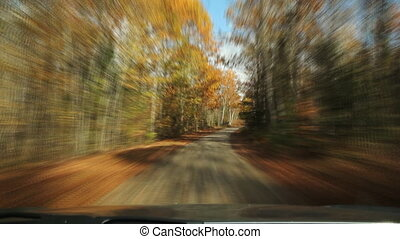 Driving down fall road. Timelapse. - Driving on an empty...