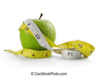 apple and measuring tape - fresh apple with measuring tape...