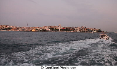Travel along Bosphorus during sunse - View from the boat,...
