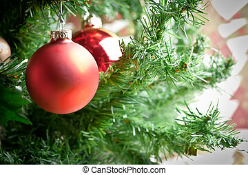 christmas ornament with tree in background